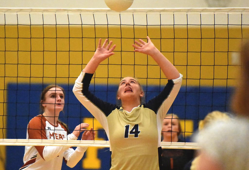 . Frederick setter Gillian Ridgley passes against Mead during the teams\' match on Tuesday, Sept. 11, at Frederick High School.