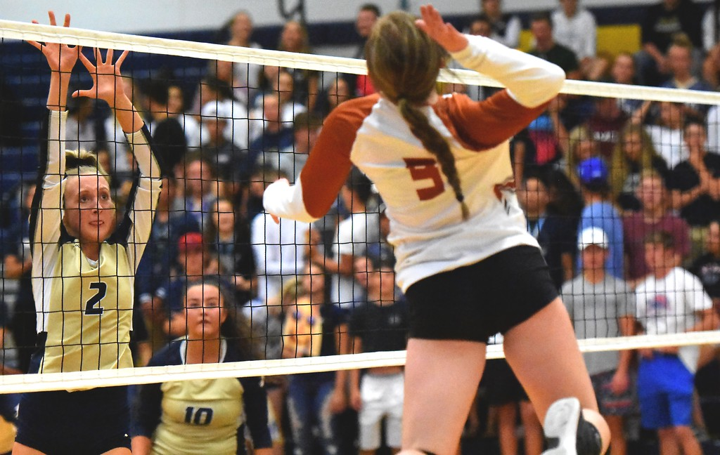 . Frederick\'s Bailey Baumgardner goes up for a block against Mead during the teams\' match on Tuesday, Sept. 11, at Frederick High School.