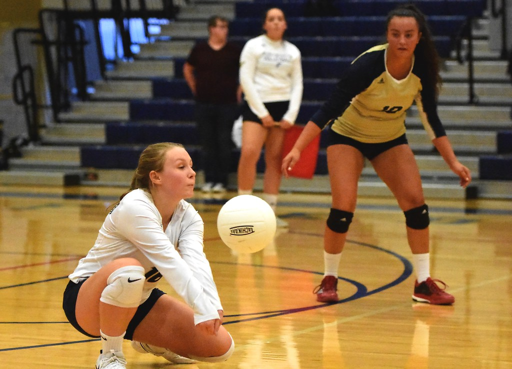 . Frederick\'s Ashlynn Grant-Miller digs the ball against Mead during the teams\' match on Tuesday, Sept. 11, at Frederick High School.