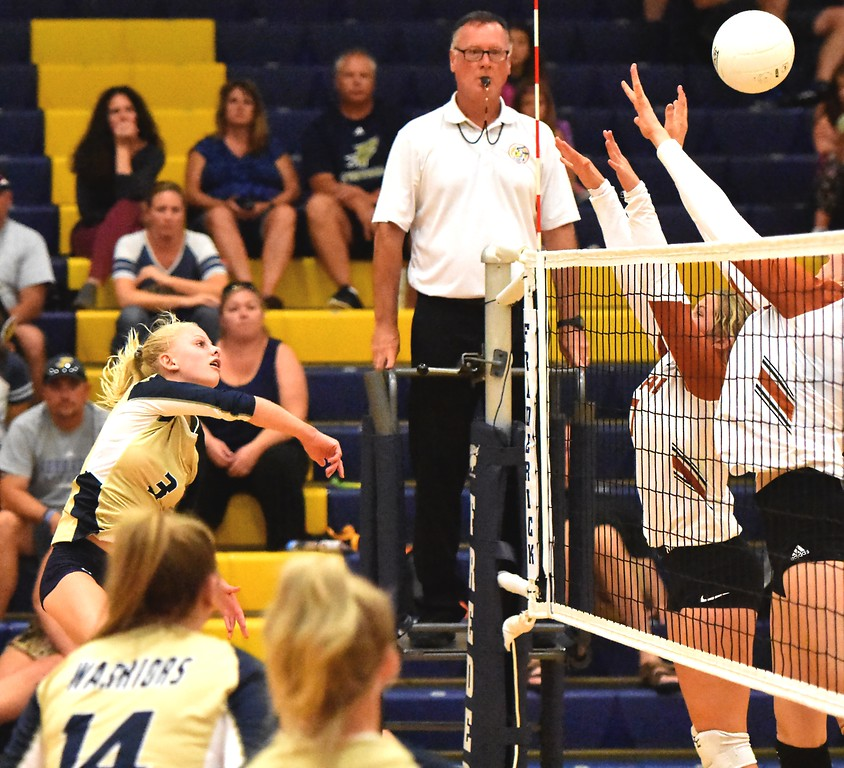 . Frederick\'s Kinley Lindhardt hits against the Mead block during the teams\' match on Tuesday, Sept. 11, at Frederick High School.