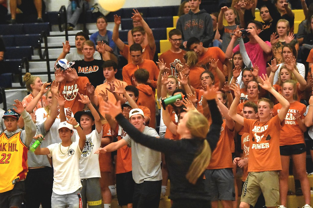 . The Mead student section cheers while Hope Borger serves against Frederick during the teams\' match on Tuesday, Sept. 11, at Frederick High School.