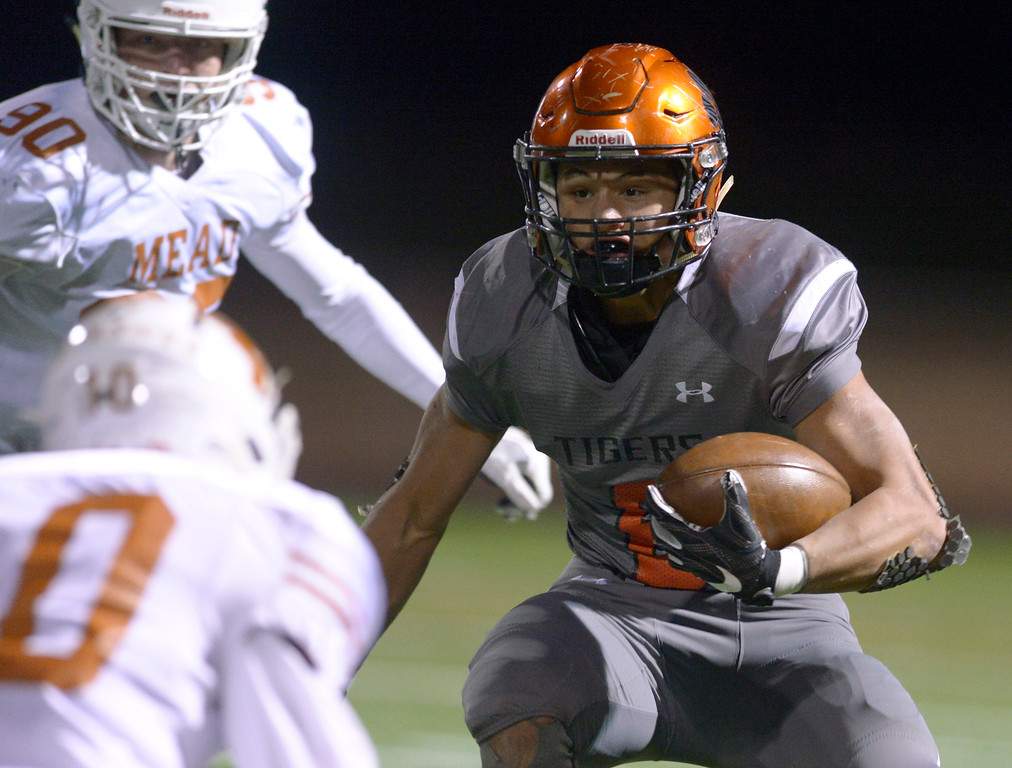 . Erie\'s Noah Roper carries the ball in the second quarter against Mead Friday night at Erie High School. To view more photos visit bocopreps.com. Lewis Geyer/Staff Photographer Oct. 24, 62017