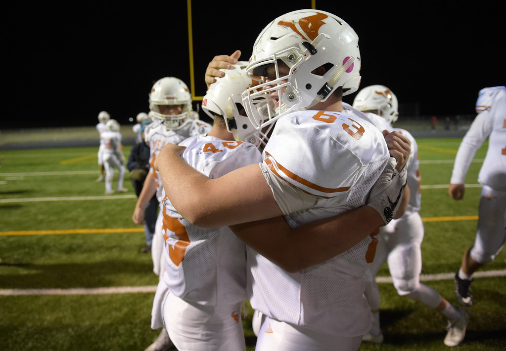 . Mead\'s Preston Hall, right, hugs teammate Nathan Mackey after Mead beat Erie 42-28 Friday night at Erie High School. To view more photos visit bocopreps.com. Lewis Geyer/Staff Photographer Oct. 24, 62017