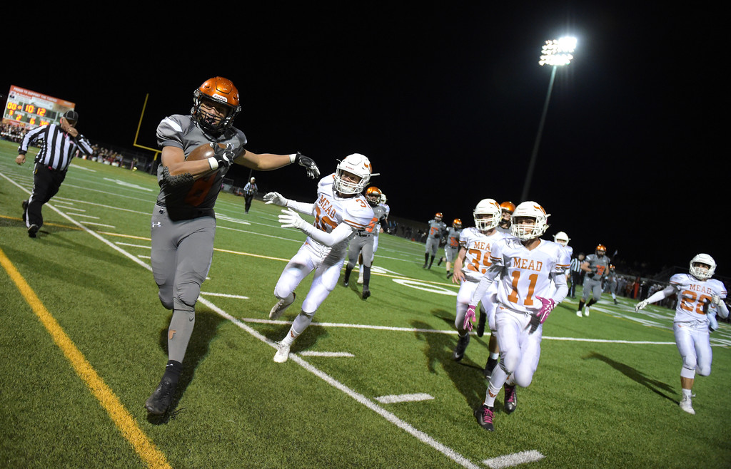 . Erie\'s Noah Roper is run out of bounds by Mead\'s Bryson Tillema in the first quarter Friday night at Erie High School. To view more photos visit bocopreps.com. Lewis Geyer/Staff Photographer Oct. 24, 62017