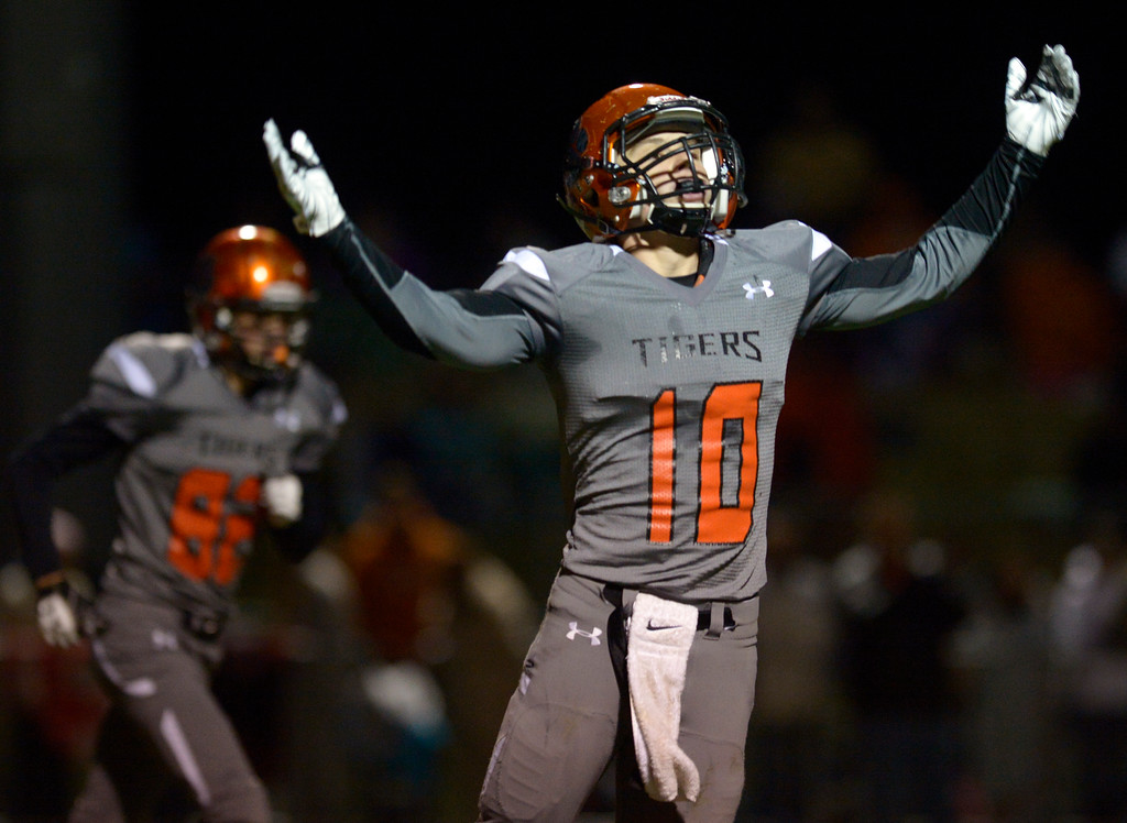 . Erie\'s Jacob Mansdorfer celebrates a second quarter touchdown from teammate Noah Roper against Mead Friday night at Erie High School. To view more photos visit bocopreps.com. Lewis Geyer/Staff Photographer Oct. 24, 62017