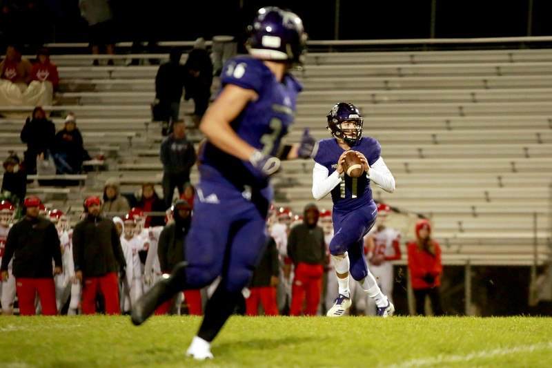 Mountain View's (11) Lukas Arthur looks for an opening as teammate (36) Tobin Armstrong anticipates the next play on Friday night's game on Oct. 5, 2018 against Brighton at Patterson Stadium in Loveland<br /> Photo by Taelyn Livingston/ Loveland Reporter-Herald
