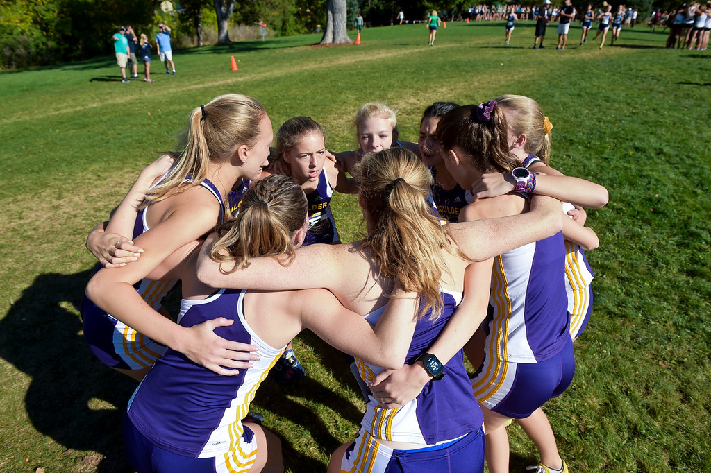 . BOULDER, CO - SEPTEMBER 22, 2018: Boulder High\'s girls varsity cross country team gathers before their start at the Pat Patten Cross Country Invitational Sept. 22 in Boulder. (Photo by Lewis Geyer/Staff Photographer)