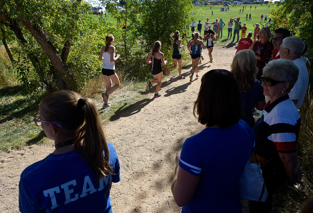 . BOULDER, CO - SEPTEMBER 22, 2018: Participants in the girls varsity race cross the creek during the Pat Patten Cross Country Invitational Sept. 22 in Boulder. (Photo by Lewis Geyer/Staff Photographer)