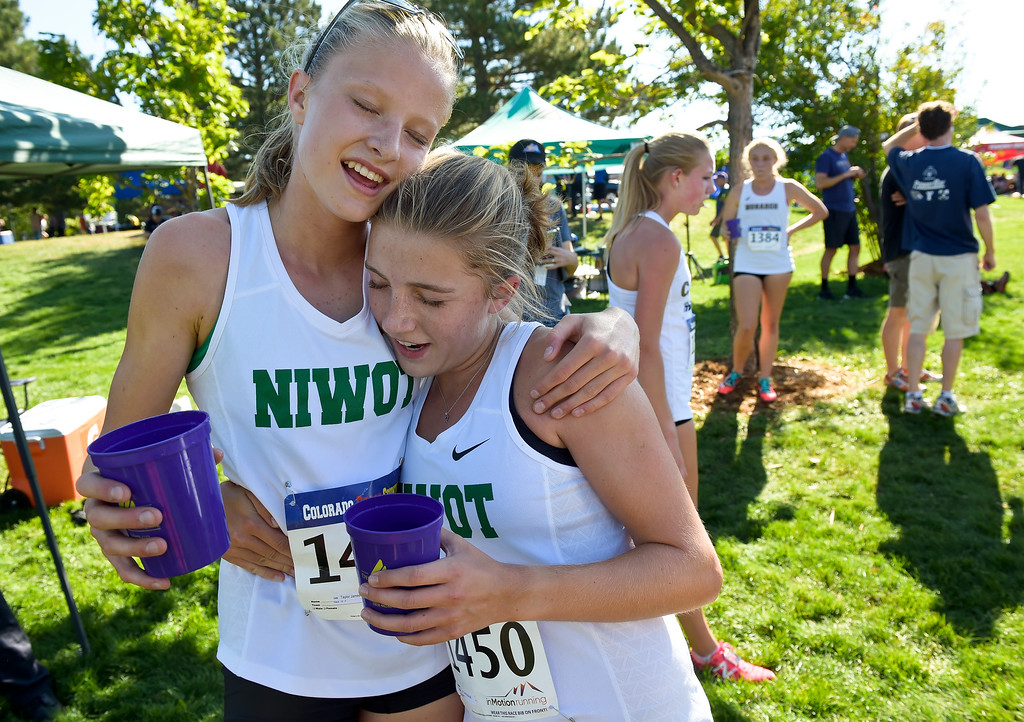 . BOULDER, CO - SEPTEMBER 22, 2018: Niwot teammates Taylor James, left, and Joelle McDonald hug after competing in the Pat Patten Cross Country Invitational Sept. 22 in Boulder. (Photo by Lewis Geyer/Staff Photographer)