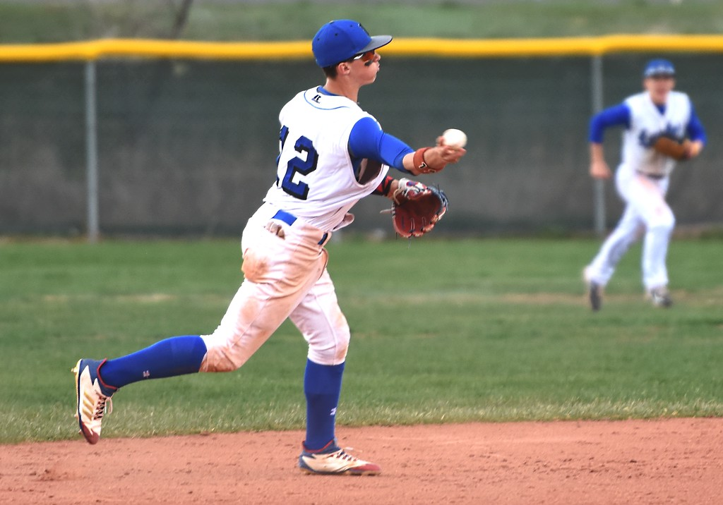 . Broomfield shortstop Trenton Harris throws to first during the Eagles\' game against Rocky Mountain on Thursday, April 12, at Broomfield High School.