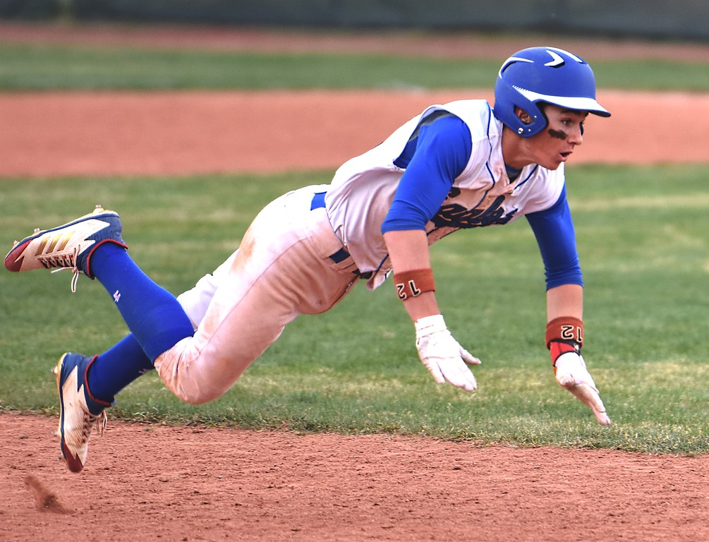 . Broomfield\'s Trenton Harris slides into third base during the Eagles\' game against Rocky Mountain on Thursday, April 12, at Broomfield High School.