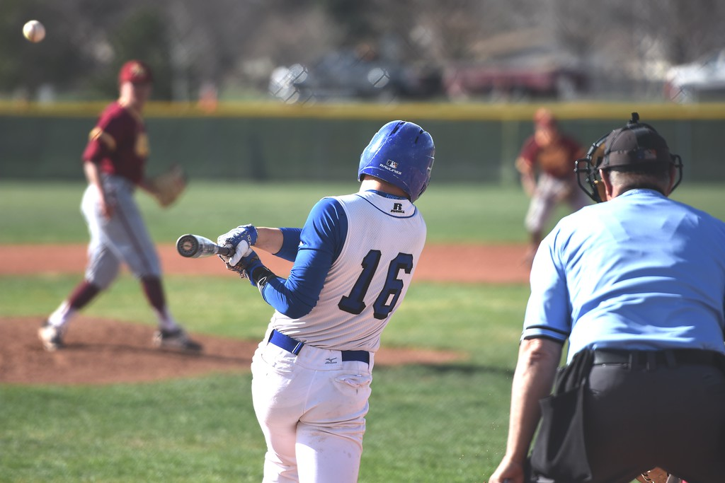 . Broomfield\'s Tanner Garner rips a line drive to left field during the Eagles\' game against Rocky Mountain on Thursday, April 12, at Broomfield High School.
