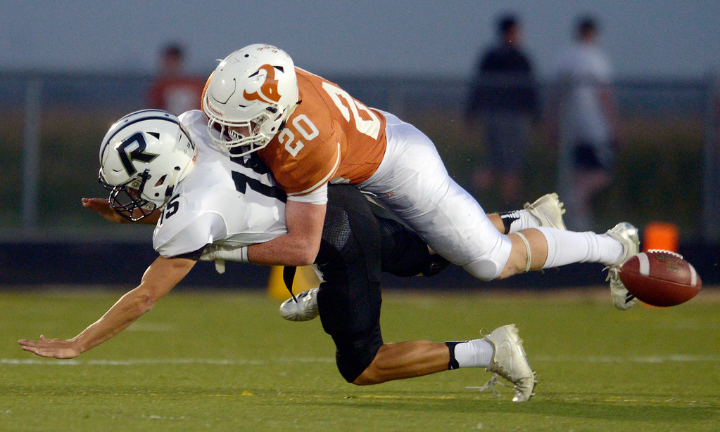 . MEAD, CO - SEPTEMBER 14, 2018: Mead\'s Devon Edwards causes Roosevelt\'s Trent Beall to fumble in the first quarter at Mead High School Sep. 14. The fumble was recovered by Mead. (Photo by Lewis Geyer/Staff Photographer)