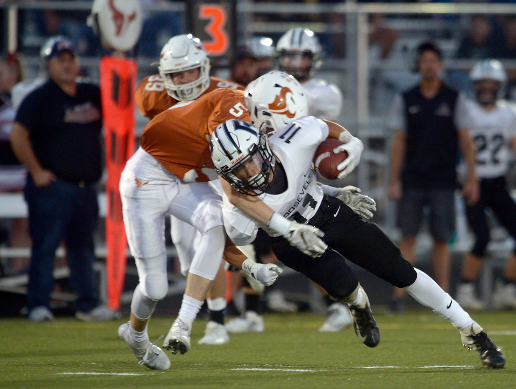. MEAD, CO - SEPTEMBER 14, 2018: Mead\'s Trey Ward tackles Roosevelt\'s Tyler Crook in the first quarter at Mead High School Sep. 14. (Photo by Lewis Geyer/Staff Photographer)