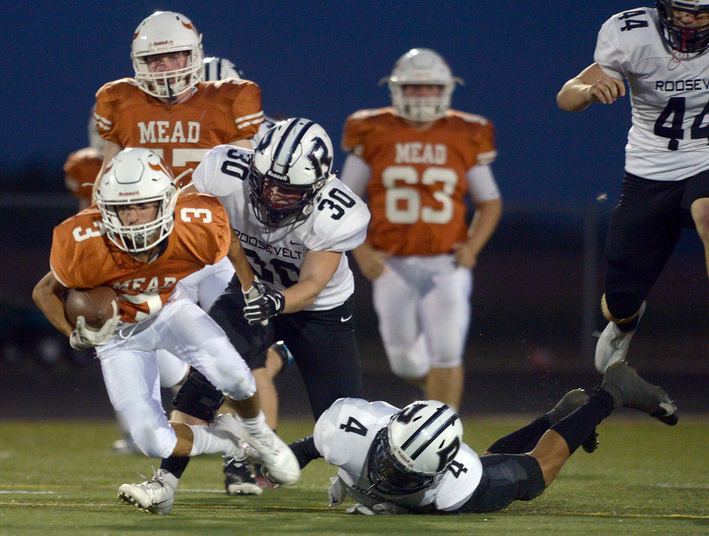 . MEAD, CO - SEPTEMBER 14, 2018: Mead\'s Brayden Keys is tackled by Roosevelt\'s Connor Doucette in the second quarter at Mead High School Sep. 14. (Photo by Lewis Geyer/Staff Photographer)