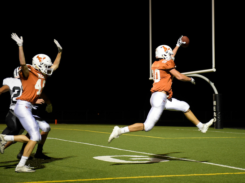 . MEAD, CO - SEPTEMBER 14, 2018: Mead\'s Jay Olson leaps steps into the end zone with a blocked punt against Roosevelt in the third quarter at Mead High School Sep. 14. (Photo by Lewis Geyer/Staff Photographer)