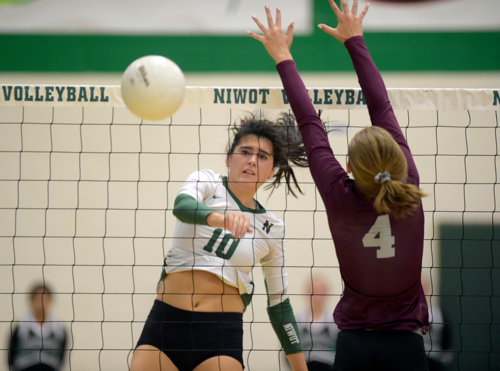 . NIWOT, CO - SEPTEMBER 11, 2018: Niwot\'s Zoe Gonzales spikes the ball during the first game in front of Silver Creek\'s Megan Sotirof at Niwot High School Sep. 11. Niwot won in three games. (Photo by Lewis Geyer/Staff Photographer)