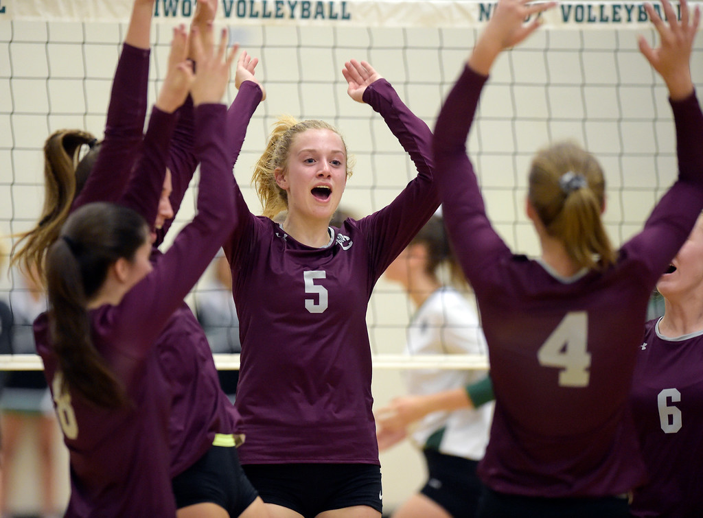 . NIWOT, CO - SEPTEMBER 11, 2018: Kaitlin James and the rest of the Silver Creek team celebrate a point scored against Niwot in the first game at Niwot High School Sep. 11. Niwot won in three games. (Photo by Lewis Geyer/Staff Photographer)