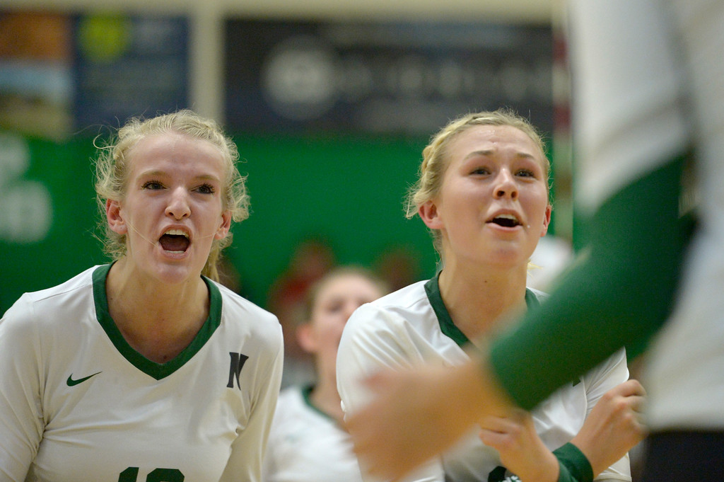 . NIWOT, CO - SEPTEMBER 11, 2018: Niwot\'s Emma Falk, left, and Madison Schoeder celebrate a point scored against Silver Creek during the second game at Niwot High School Sep. 11. Niwot won in three games. (Photo by Lewis Geyer/Staff Photographer)