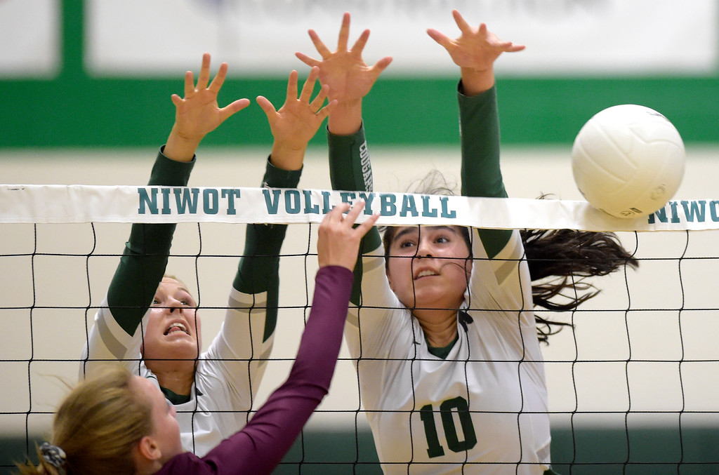 . NIWOT, CO - SEPTEMBER 11, 2018: Niwot\'s Madison Schoeder, left, and Zoe Gonzales block a shot against Silver Creek during the first game at Niwot High School Sep. 11. Niwot won in three games. (Photo by Lewis Geyer/Staff Photographer)
