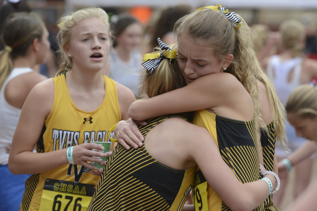 . Thompson Valley teammates Julia Lundgren, right, hugs teammate Gracy Roitsch after the state cross country championship on Saturday in Colorado Springs.