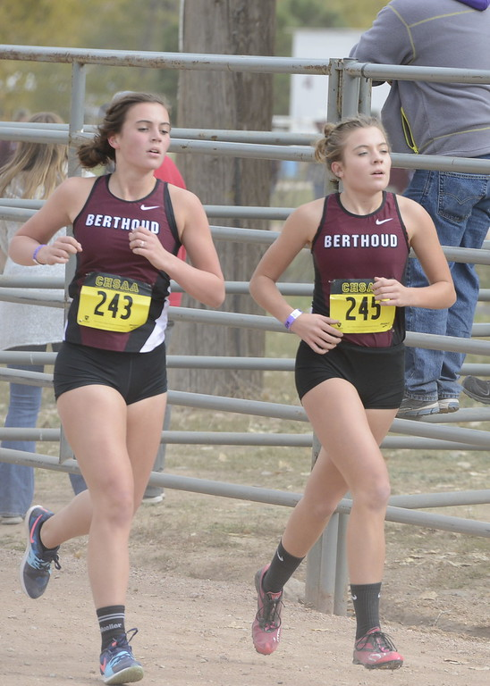 . Berthoud\'s Julianne Evans Dennison (243) and Alex Schultz (254) run in the 3A girls state cross country championship on Saturday in Colorado Springs.