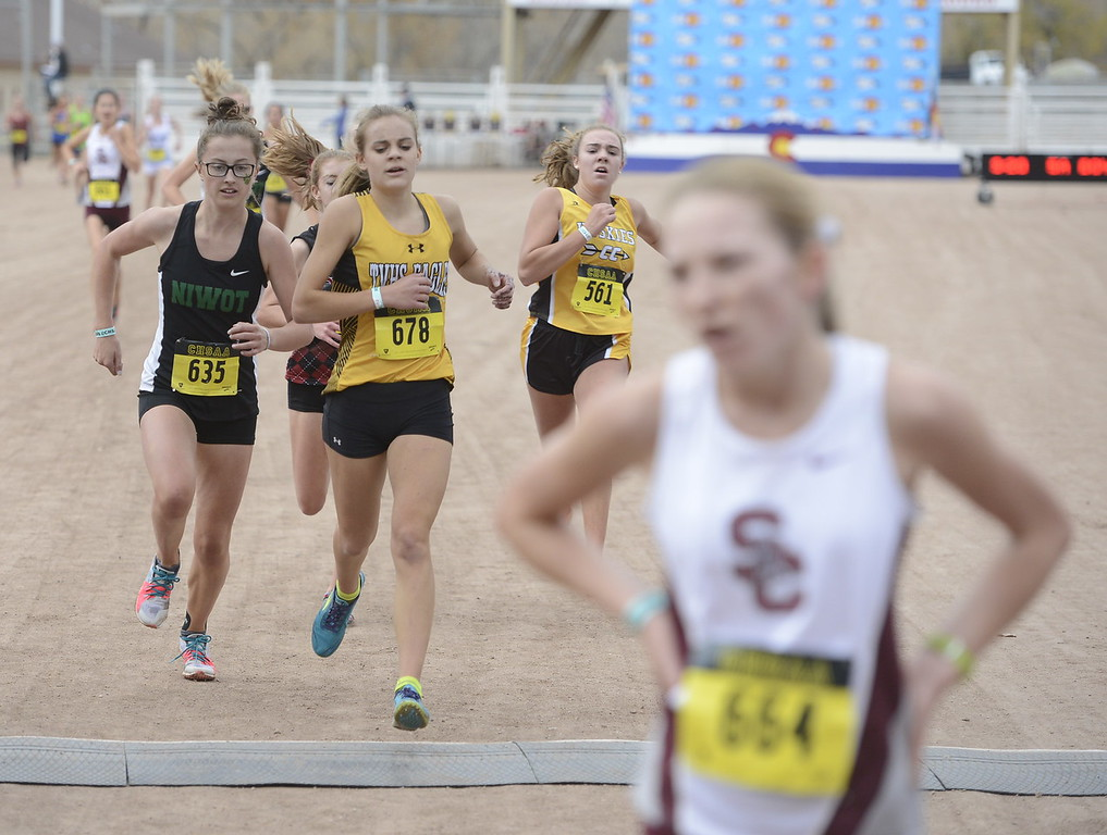 . Thompson Valley\'s Kenadi Krueger (678) crosses the finish line in the 4A girls state cross country championship on Saturday in Colorado Springs.
