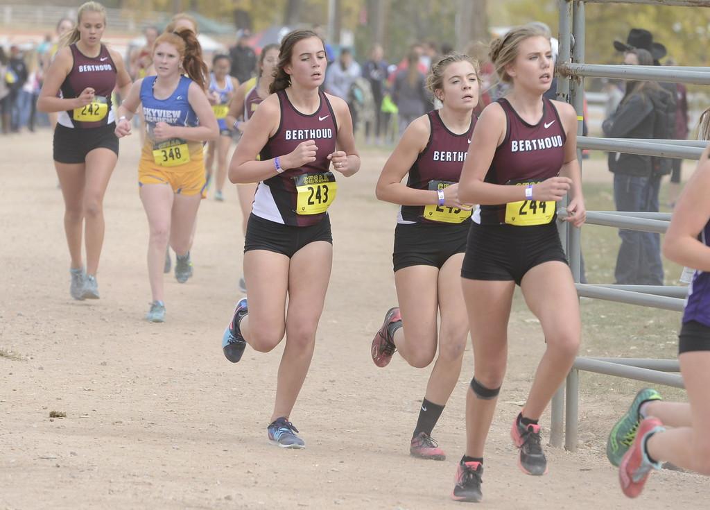 . Berthoud\'s Julianne Evans Dennison (243),  Alex Schultz (245) and Alyssa Radloff (244) run in the 3A girls state cross country championship on Saturday in Colorado Springs.