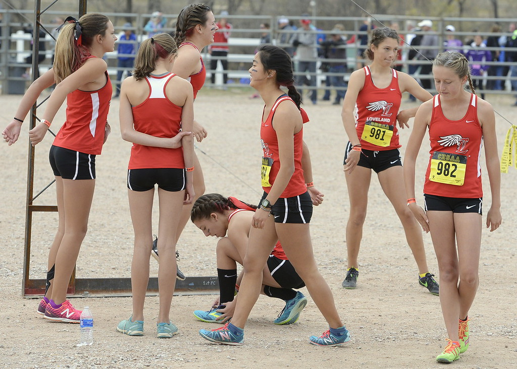 . The Loveland girls cross country team prepares to run in the 5A state championship on Saturday in Colorado Springs.