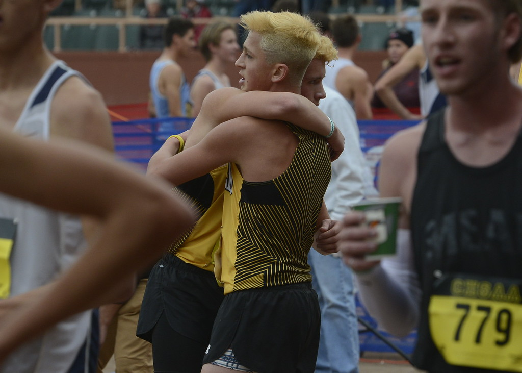 . Thompson Valley\'s Jacob Regalado, left, embraces teammate Hayden Ell after finishing the 4A boys state cross country championship on Saturday in Colorado Springs.