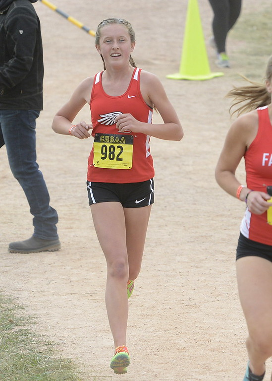 . Loveland\'s Alix Huhta competes in the 5A girls state cross country championship on Saturday in Colorado Springs.