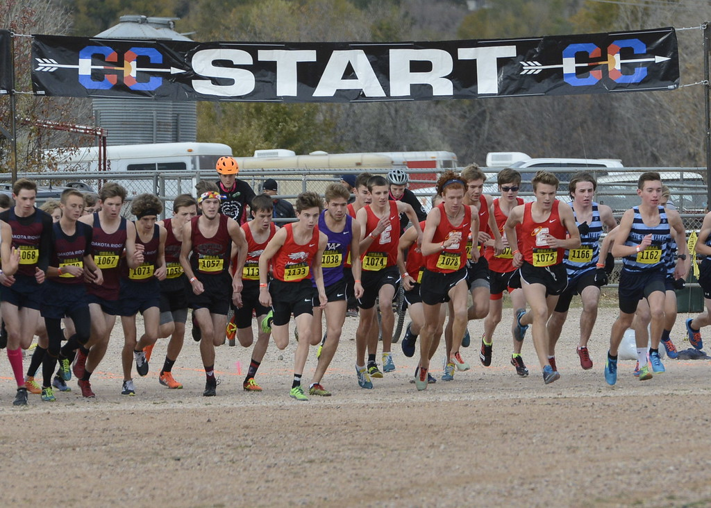 . Loveland\'s Zac Witman (1133) and teammate Kellis Ward (1132) begin the 5A boys state cross country championship race on Saturday in Colorado Springs.