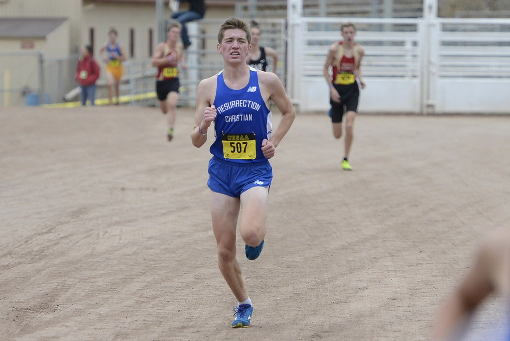 . Christian Fagerlin of Resurrection Christian makes his way to the finish line at the 4A boys state cross country championship on Saturday in Colorado Springs.