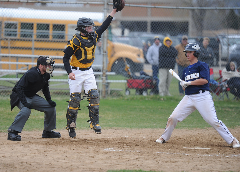 . Thompson Valley catcher Trenton Riehl leaps for a high throw during Tuesday\'s game against Frederick at Constantz Field. (Sean Star/Loveland Reporter-Herald)
