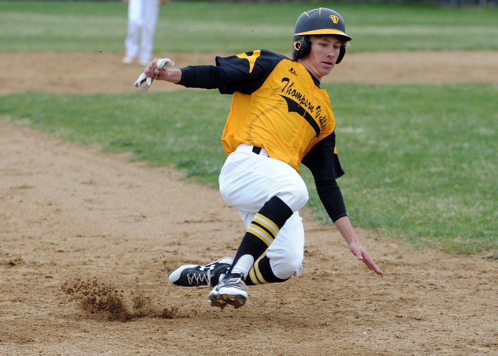 . Thompson Valley\'s Tristan Schatz slides safely into third base during Tuesday\'s game against Frederick at Constantz Field. (Sean Star/Loveland Reporter-Herald)
