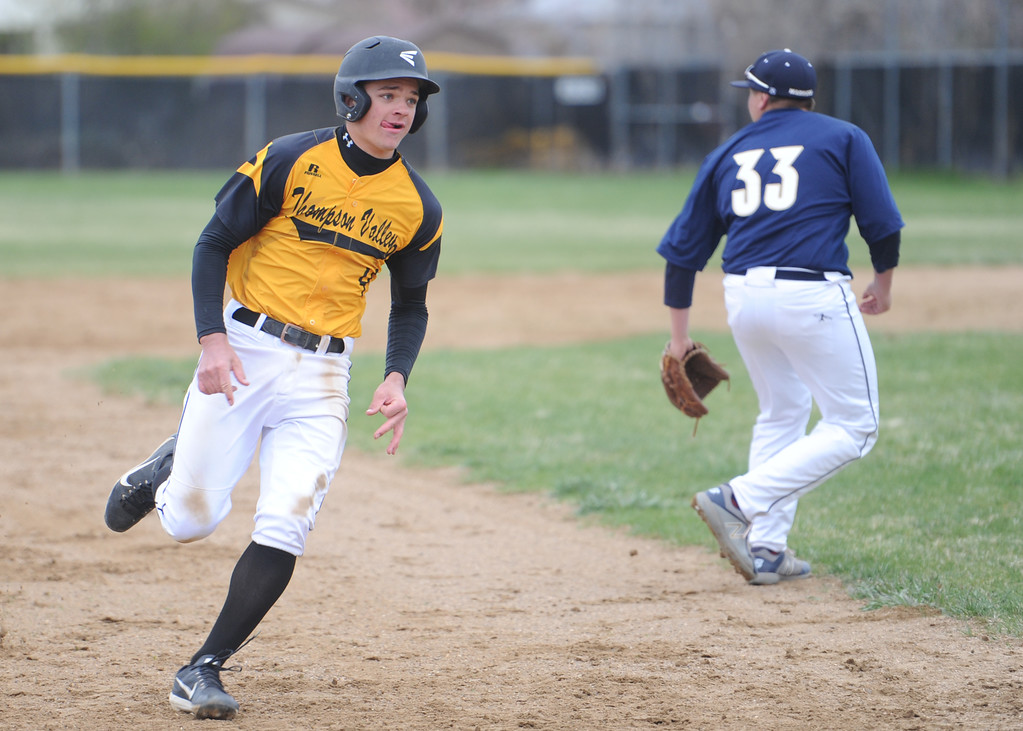 . Thompson Valley\'s Cameron Nellor rounds third during Tuesday\'s game against Frederick at Constantz Field. (Sean Star/Loveland Reporter-Herald)