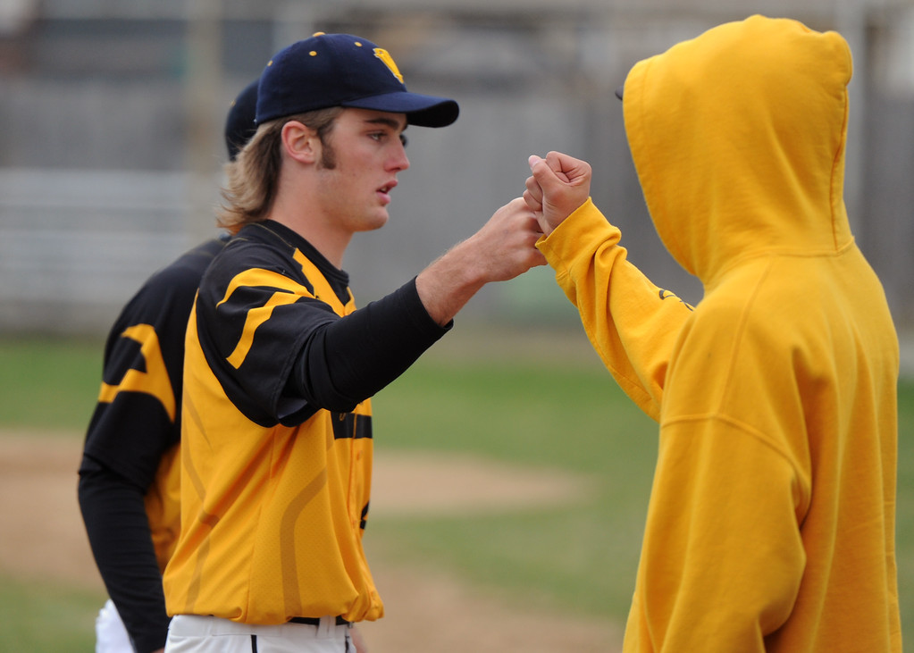 . Thompson Valley\'s Jake Hewson fist bumps a teammate during Tuesday\'s game against Frederick at Constantz Field. (Sean Star/Loveland Reporter-Herald)