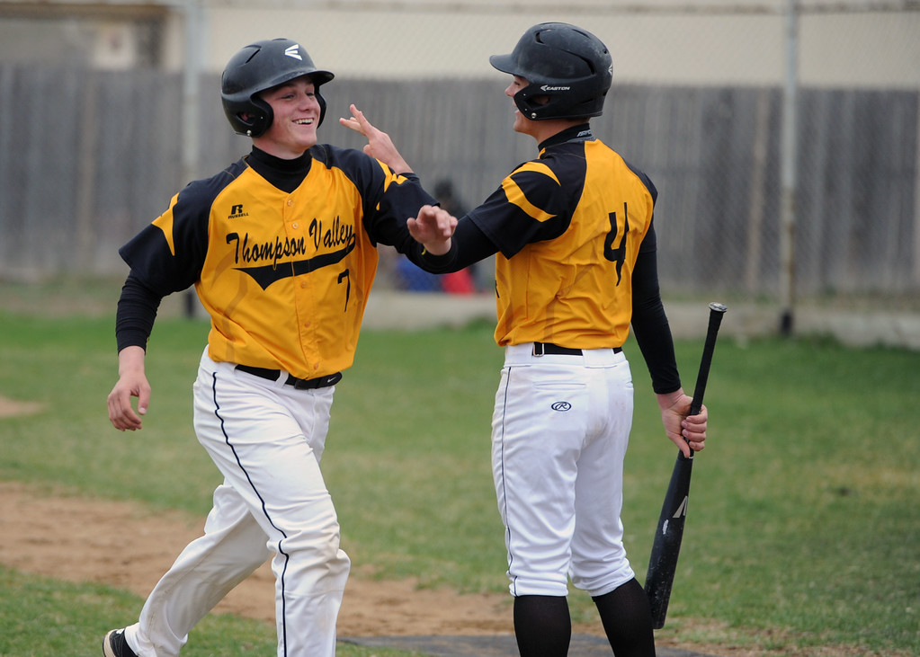 . Thompson Valley\'s Trenton Riehl is congratulated by teammate Cameron Nellor during Tuesday\'s game against Frederick at Constantz Field. (Sean Star/Loveland Reporter-Herald)