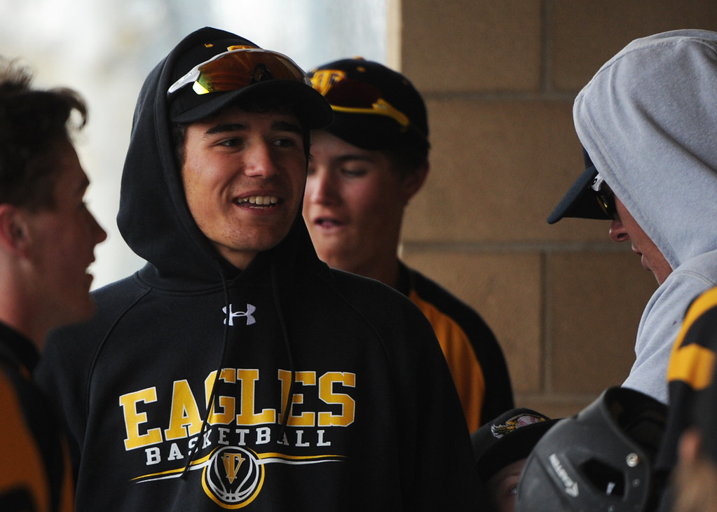 . Thompson Valley\'s Adrian Juarez chats with a teammate during Tuesday\'s game against Frederick at Constantz Field. (Sean Star/Loveland Reporter-Herald)