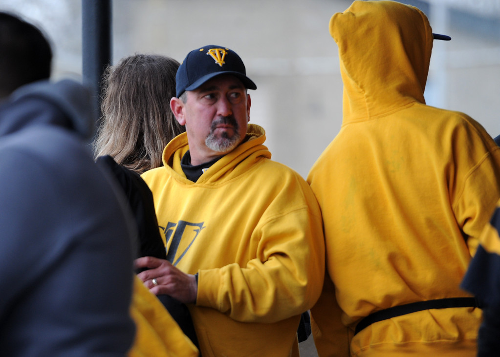 . Thompson Valley coach Bruce Kelly in the dugout during Tuesday\'s game against Frederick at Constantz Field. (Sean Star/Loveland Reporter-Herald)