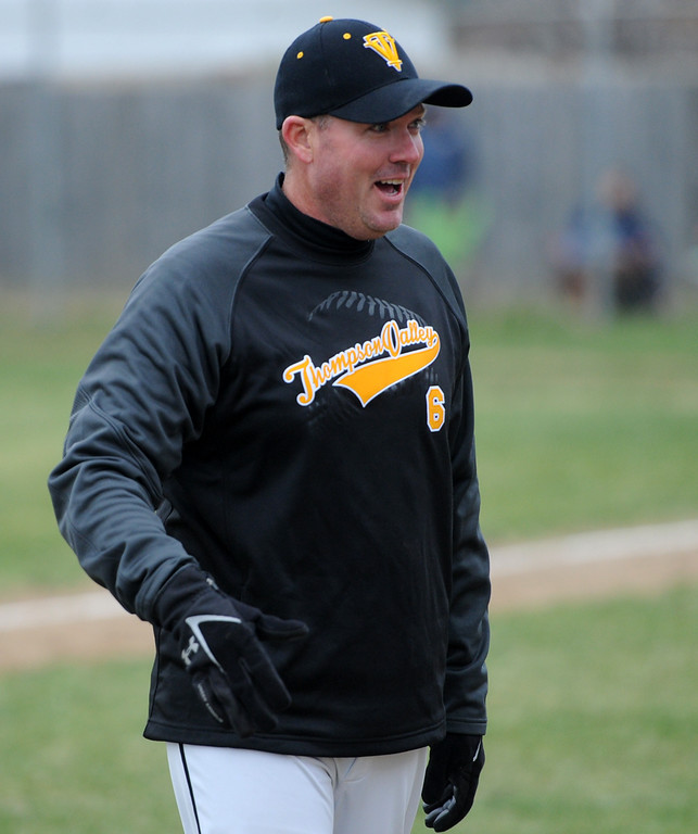 . Thompson Valley coach Jay Denning reacts after dodging a foul ball during Tuesday\'s game against Frederick at Constantz Field. (Sean Star/Loveland Reporter-Herald)