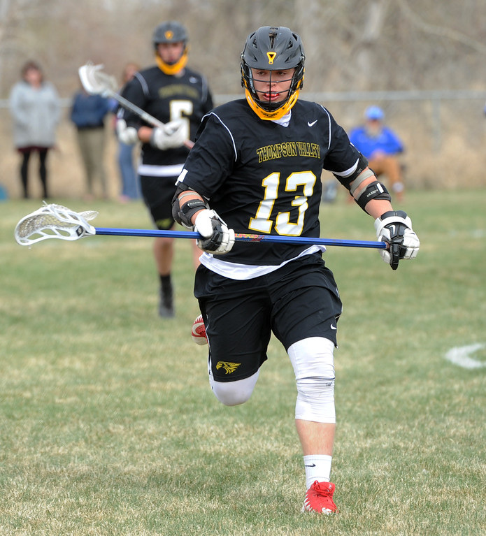 . Thompson Valley\'s Travis Bretches runs to a loose ball during a game on Thursday, April 19, 2018 at Dawson School in Lafayette, Colorado. (Sean Star/Loveland Reporter-Herald)