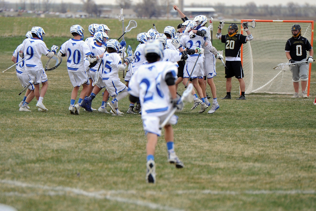 . Dawson celebrates after scoring the game-winning goal in the final second to beat Thompson Valley 10-9 on Thursday at Dawson School. (Sean Star/Loveland Reporter-Herald)