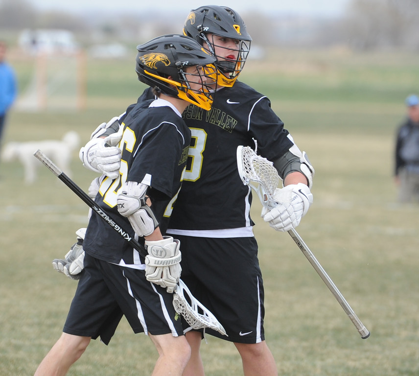 . Thompson Valley\'s Greg Bilek, left, celebrates his goal with Colby Mauck during a game on Thursday, April 19, 2018 at Dawson School in Lafayette, Colorado. (Sean Star/Loveland Reporter-Herald)