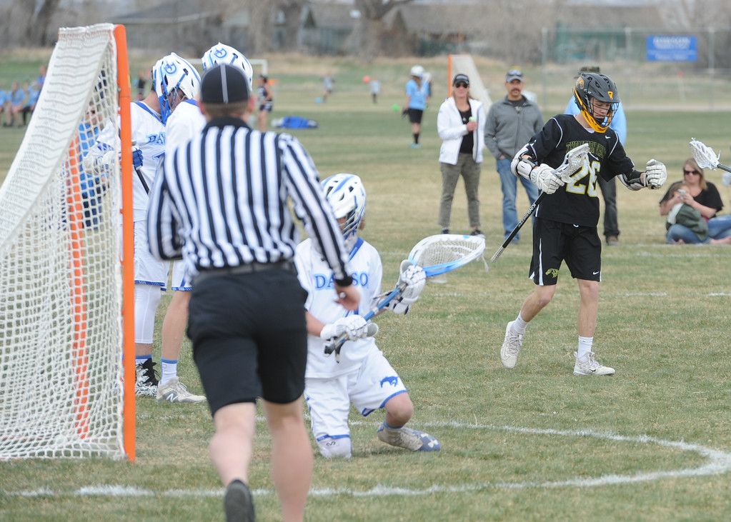 . Thompson Valley\'s Greg Bilek, right, scores one of his seven goals during a game on Thursday, April 19, 2018 at Dawson School in Lafayette, Colorado. (Sean Star/Loveland Reporter-Herald)