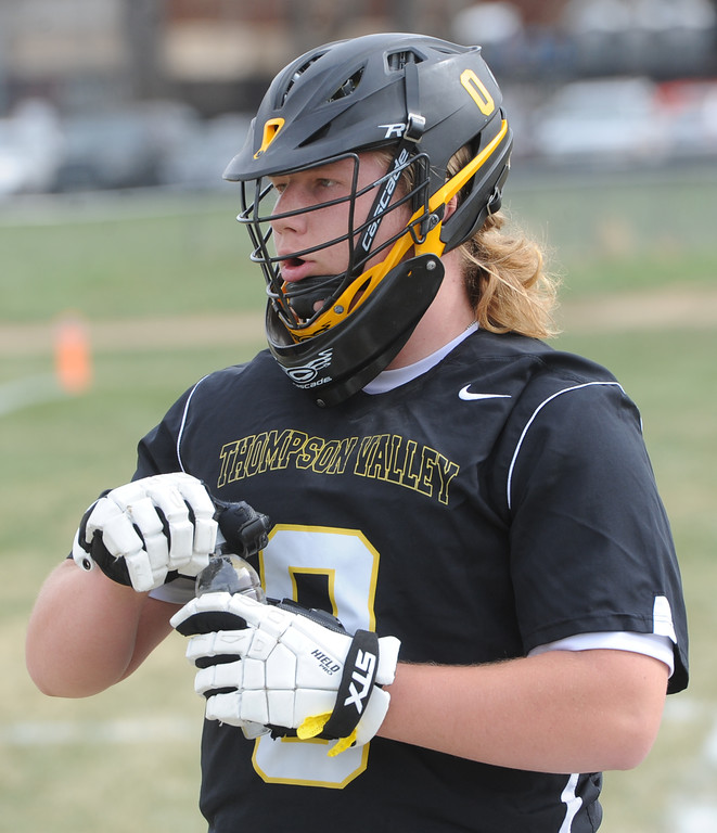 . Thompson Valley\'s Corbin Shilling grabs a drink before a game on Thursday, April 19, 2018 at Dawson School in Lafayette, Colorado. (Sean Star/Loveland Reporter-Herald)