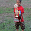 The Future<br /> just as I was packing it in for the day I noticed this boy posing for his mom  (and her Mobile) with the Runners Up trophy :)