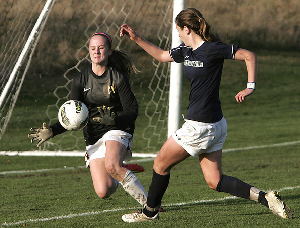 KEN YUSZKUS/Staff photo.  Pingree's Kerri Zerfoss, runs the ball into the Marianapolis goalie, but just misses a goal during the Pingree girls soccer vs. Marianapolis (Conn.) Prep in NEPSAC playoff quarterfinals.  11/12/14