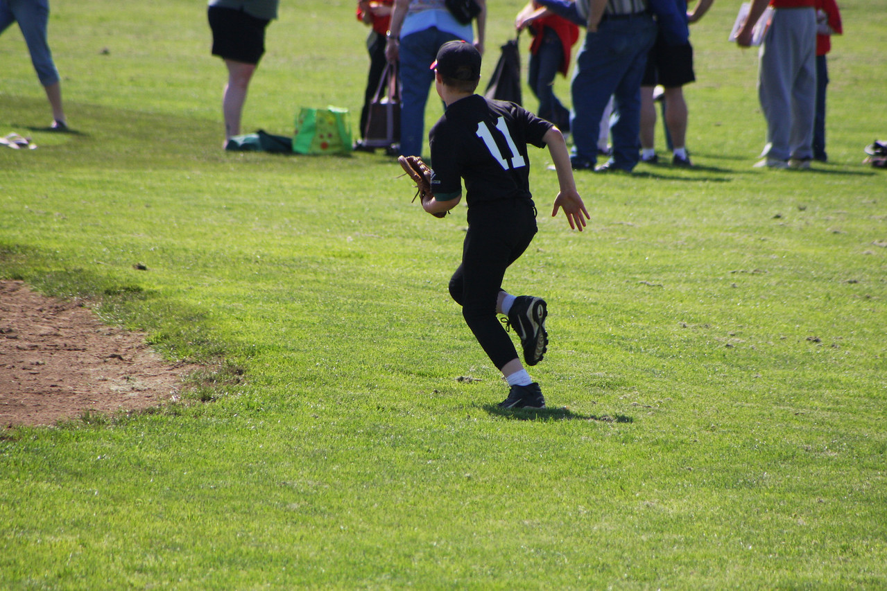 Blecah (11) chases down ground ball.