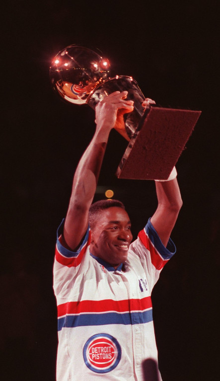 . Pistons Isiah Thomas hoists the Pistons first NBA Championship trophy over his head in a ceremony opening night of the Pistons 1989-1990 season vs The New York Nicks on 11-3-89.